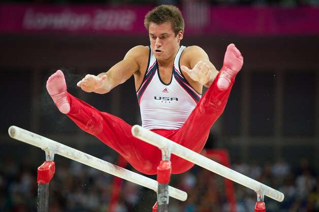 Sam Mikulak of the USA performs on the parallel  bars during the men's gymnastics team final at the 2012 London Olympics on Monday, July 30, 2012. The USA finished in 5th place. (Smiley N. Pool / Houston Chronicle)