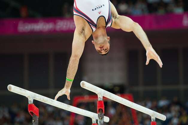Danell Leyva of the USA performs on the parallel bars during the men's gymnastics team final at the 2012 London Olympics on Monday, July 30, 2012. The USA finished in 5th place. (Smiley N. Pool / Houston Chronicle)