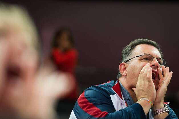 USA Gymnastics president Steve Penny shouts encouragement to the team during the men's gymnastics team final at the 2012 London Olympics on Monday, July 30, 2012. The USA finished in 5th place. (Smiley N. Pool / Houston Chronicle)