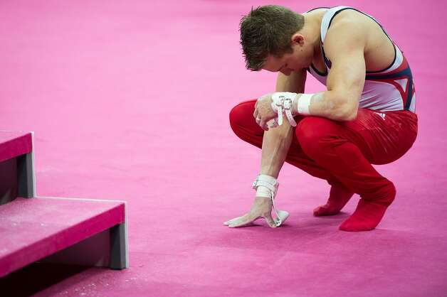 Jonathan Horton prays before performing on the horizontal bar during the men's gymnastics team final at the 2012 London Olympics on Monday, July 30, 2012. The USA finished in 5th place. (Smiley N. Pool / Houston Chronicle)