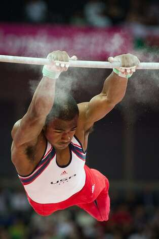 John Orozco of the USA performs on the horizontal bar during the men's gymnastics team final at the 2012 London Olympics on Monday, July 30, 2012. The USA finished in 5th place. (Smiley N. Pool / Houston Chronicle)