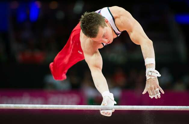 Jonathan Horton performs on the horizontal bar during the men's gymnastics team final at the 2012 London Olympics on Monday, July 30, 2012. The USA finished in 5th place. (Smiley N. Pool / Houston Chronicle)