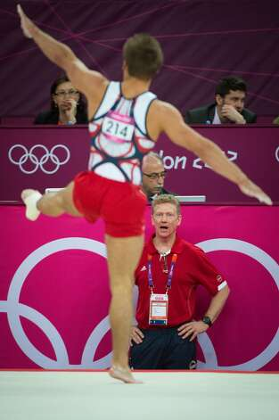 Coach Kevin Mazeika of Houston watches Sam Mikulak perform his floor exercise during the men's gymnastics team final at the 2012 London Olympics on Monday, July 30, 2012. The USA finished in 5th place. (Smiley N. Pool / Houston Chronicle)