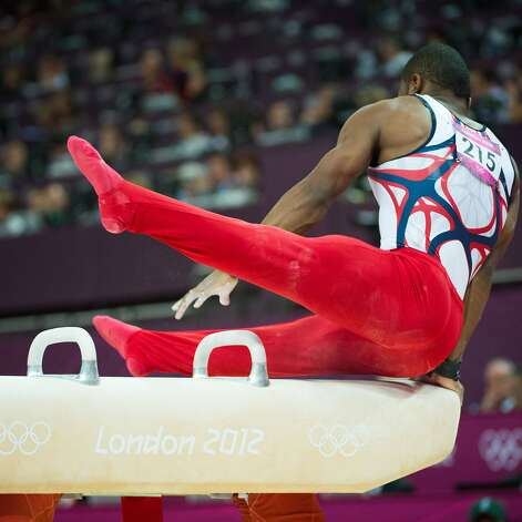 John Orozco of the USA slips on the pommel horse during the men's gymnastics team final at the 2012 London Olympics on Monday, July 30, 2012. The USA finished in 5th place. (Smiley N. Pool / Houston Chronicle)