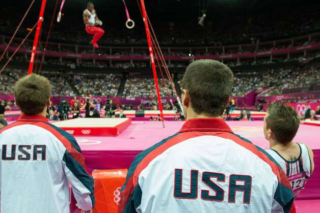 Sam Mikulak , Jake Dalton and Jonathan Horton watch as John Orozco performs on the still rings during the men's gymnastics team final at the 2012 London Olympics on Monday, July 30, 2012. The USA finished in 5th place. (Smiley N. Pool / Houston Chronicle)