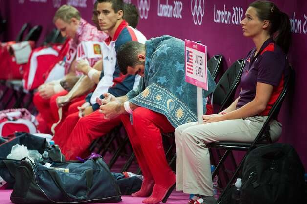 Danell Leyva of the USA hangs his head after performing on the pommel horse during the men's gymnastics team final at the 2012 London Olympics on Monday, July 30, 2012. The USA finished in 5th place. (Smiley N. Pool / Houston Chronicle)