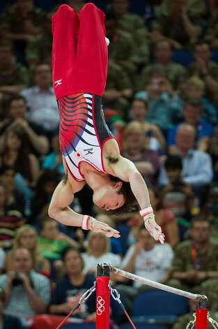 Kohei Uchimura of Japan performs on the horizontal bar during the men's gymnastics team final at the 2012 London Olympics on Monday, July 30, 2012. The USA finished in 5th place. (Smiley N. Pool / Houston Chronicle)