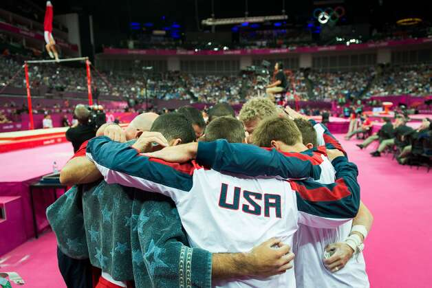 Team USA huddles before performing on the horizontal bar, their final apparatus of the competition, during the men's gymnastics team final at the 2012 London Olympics on Monday, July 30, 2012. The USA finished in 5th place. (Smiley N. Pool / Houston Chronicle)