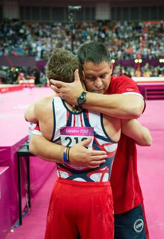 Jonathan Horton gets a hug from USA assistant coach Tom Meadows following the men's gymnastics team final at the 2012 London Olympics on Monday, July 30, 2012. The USA finished in 5th place. Meadows is Horton's coach at of Cypress Academy of Gymnastics in Houston. (Smiley N. Pool / Houston Chronicle)