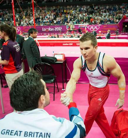 Jonthan Horton congratulate members of the Great Britain team following the men's gymnastics team final at the 2012 London Olympics on Monday, July 30, 2012. The USA finished in 5th place. Great Britain won the bronze. (Smiley N. Pool / Houston Chronicle)