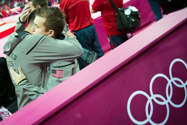 Jonathan Horton, facing, consoles Danell Leyva following the men's gymnastics team final at the 2012 London Olympics on Monday, July 30, 2012. The USA finished in 5th place. (Smiley N. Pool / Houston Chronicle)