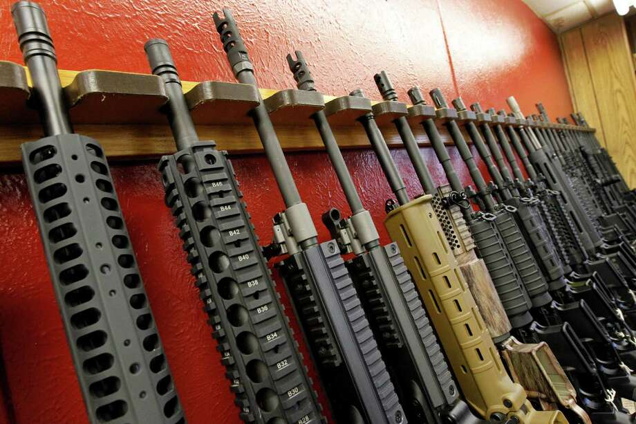 A week after the movie theater massacre in Aurora, Colo., these AR-15 style rifles were for sale at Aurora's Firing-Line indoor range and gun shop. Photo: Alex Brandon, Associated Press / AP