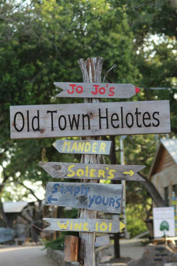 Rustic signs in Old Town Helotes point the way to various businesses. Under a development plan proposed to the City Council, the Old Town area would undergo significant economic redevelopment. Photo: Lauri Gray Eaton / Northwest Weekly