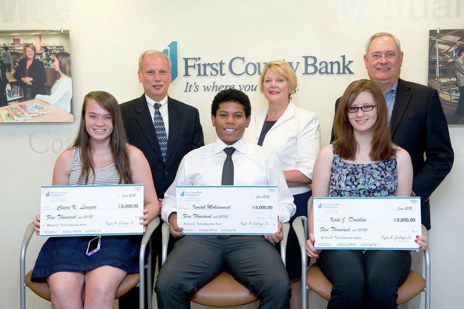 Seated from left, Claire Linegar, Darien High School, Isaiah Mohammed, Academy of Information Technology & Engineering, and Kate Donohoe, Westhill High School, each received Richard E. Taber Citizenship Award administered by the First County Bank Foundation. Standing from left, Rey Giallongo, bank chairman and CEO, Katherine Harris, bank president and chief operating officer and Richard Taber, former chairman and CEO and current bank board of directors member. July 16, 2012. Photo: Contributed Photo