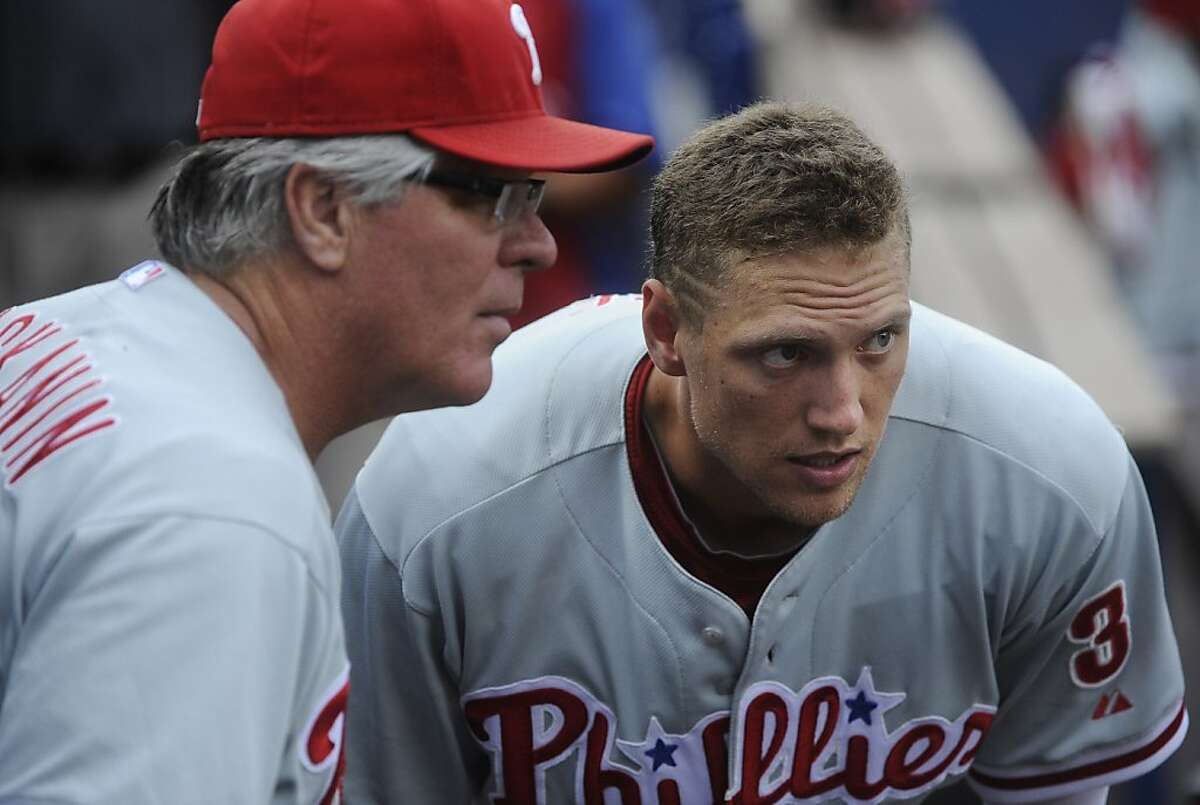 Philadelphia Phililes right fielder Hunter Pence (3) gets advice from bench coach Pete Mackanin before taking the field against the Atlanta Braves in a baseball game, Friday, July, 27, 2012. (AP Photo/John Amis)