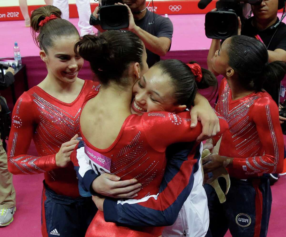 U.S. gymnast Kyla Ross, right, hugs teammate Alexandra Raisman during the Artistic Gymnastics women's team final at the 2012 Summer Olympics, Tuesday, July 31, 2012, in London. (AP Photo/Julie Jacobson)