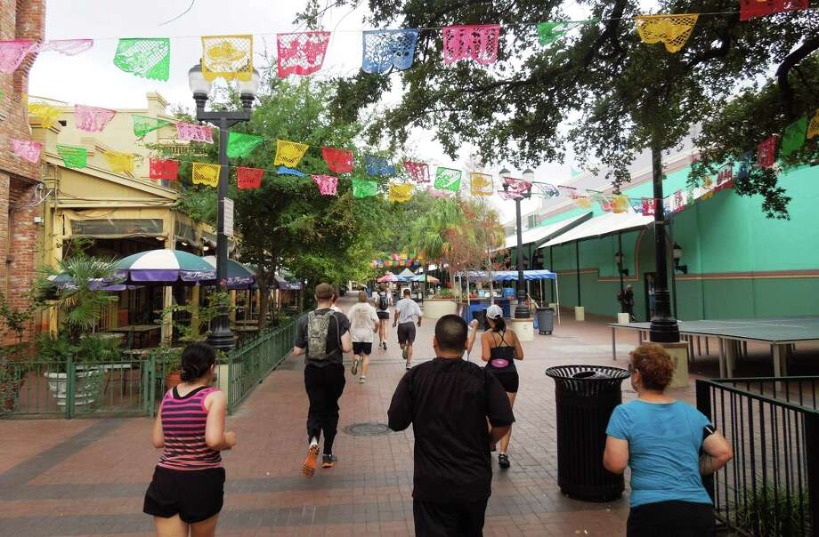 Runners head through El Mercado during the 2011 downtown River City Run Photo: Courtesy Tina Stolhandske