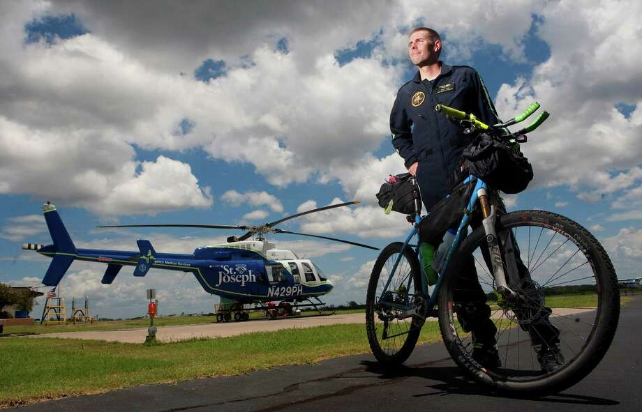 PHI flight paramedic Billy Rice recently completed the Great Divide Mountain Bike Route from Banff, Alberta, Canada, to Antelope Wells, N.M. Photo: Cody Duty, Houston Chronicle / © 2011 Houston Chronicle