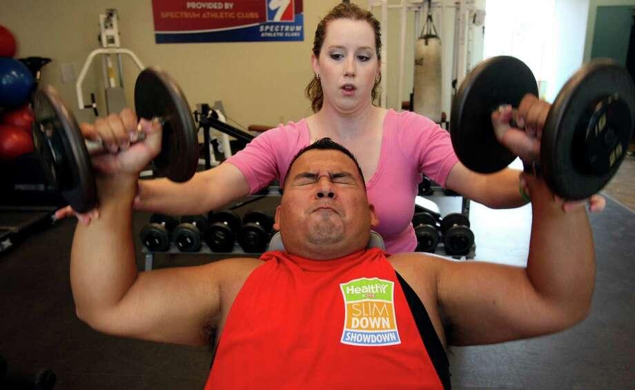 Michael Mercado is taking part in H-E-B's Slim Down Showdown, a 16-week weight-loss challenge. Photo: Helen L. Montoya, San Antonio Express-News / ©SAN ANTONIO EXPRESS-NEWS