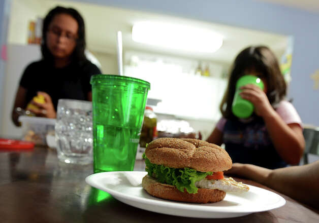 A chicken burger sits on the table ready for dinner in Dina Lopez's west side home.  Lopez is participating in the HEB Slim Down Showdown with the help of her family.  John Albright / Special to the Express-News. Photo: JOHN ALBRIGHT, Special To The Express-News