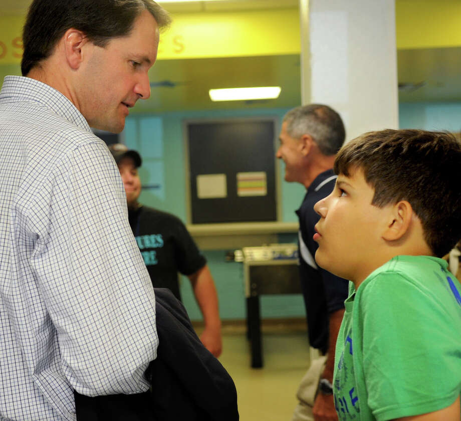U.S. Representative Jim Himes speaks to Augusto Gardel, 13, at the Greenwich Boys & Girls Club on Tuesday, July 31, 2012. Photo: Lindsay Niegelberg / Stamford Advocate