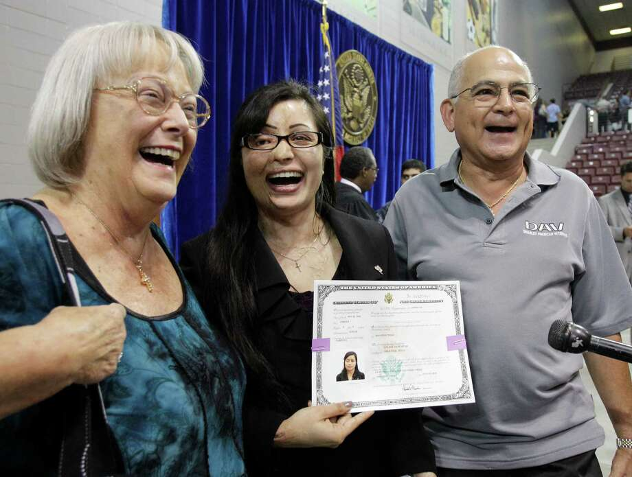 Barbara Garcia, left, Julie Aftab, and Robert Garcia, right,  celebrate after Julie's citizenship ceremony at M.O. Campbell Center, 1865 Aldine-Bender, July 31, 2012, in Houston. Robert Garcia was the assistant principle when Julie attended Deer Park High School.  Aftab came to the U.S. for medical treatment after being burned with acid by men in Pakistan who accused her of insulting Islam because she is a devout Christian. Photo: Melissa Phillip, Houston Chronicle / © 2012 Houston Chronicle