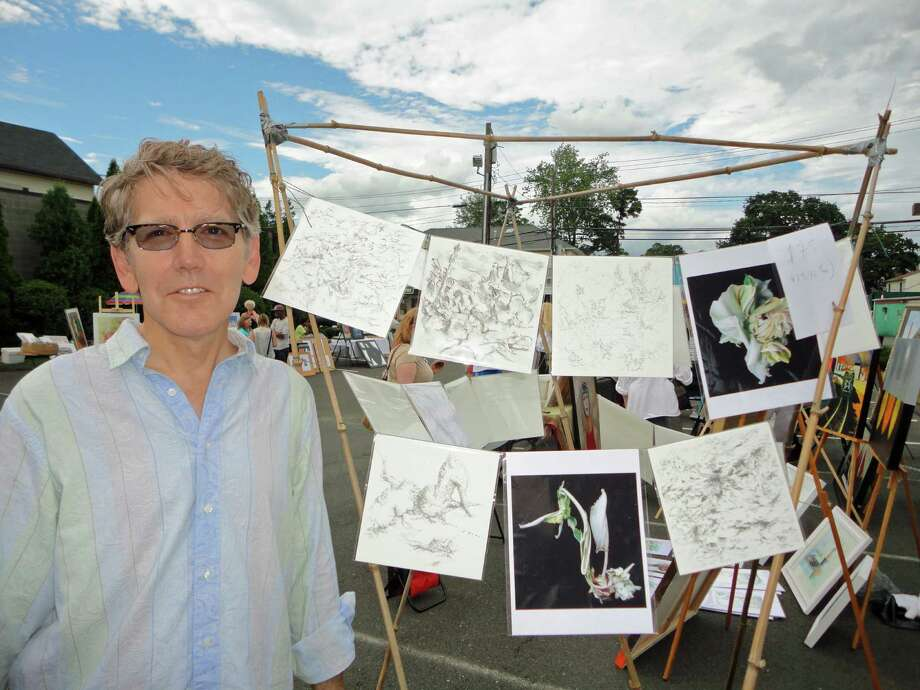 Norwalk artist Steve Hunter, depicted here at the launch party of the Greater Norwalk Arts Council at the Artists' Market in Norwalk last Thursday, looks forward to the collaboration between artists and supporters to create more of a local arts community. Photo: Meg Barone