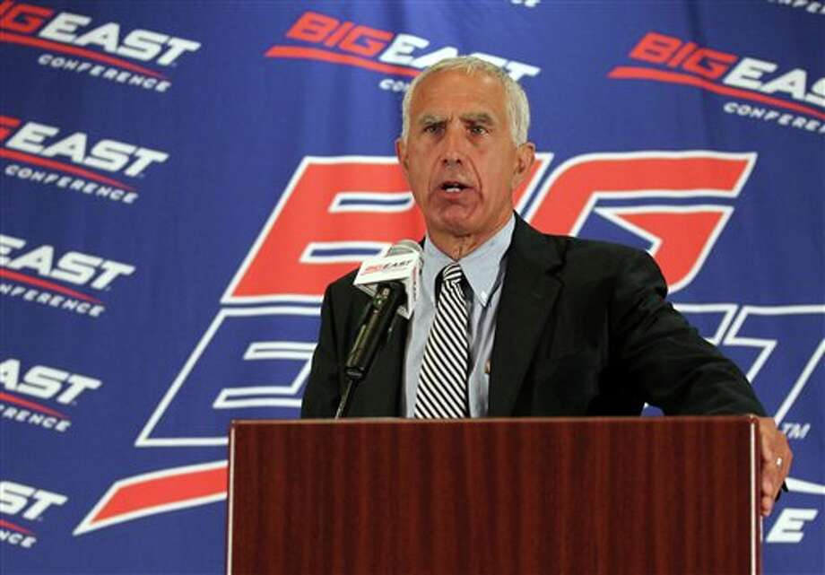 University of Connecticut head football coach Paul Pasqualoni speaks with the media during the Big East Conference NCAA college football media day, Tuesday, July 31, 2012, Newport, R.I. (AP Photo/Stew Milne)