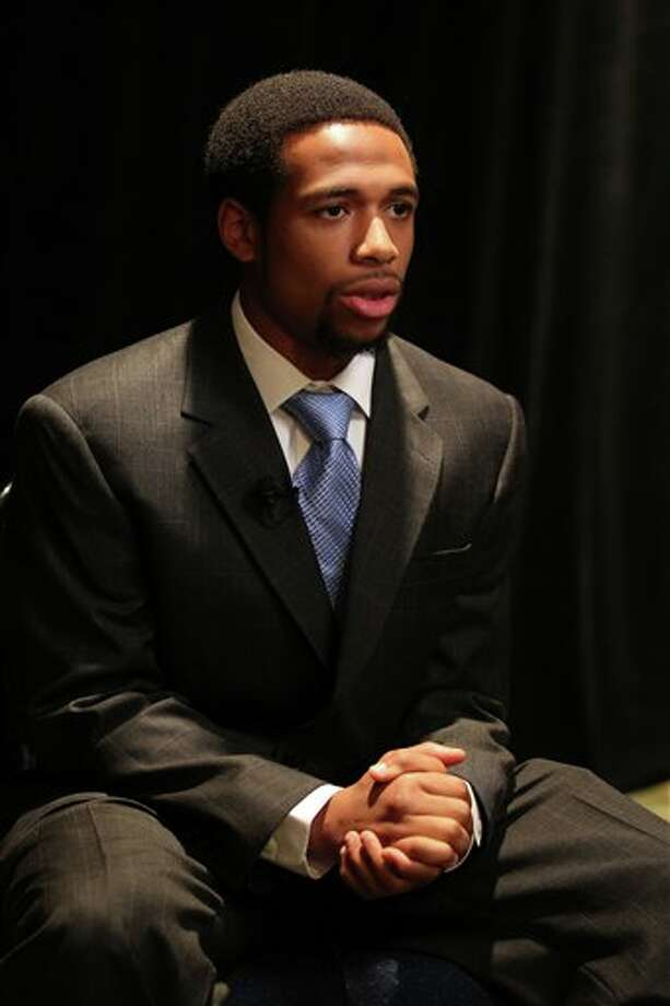 Connecticut running back Lyle McCombs answers questions during a television interview at the Big East Conference NCAA college football media day, Tuesday, July 31, 2012, Newport, R.I. (AP Photo/Stew Milne)