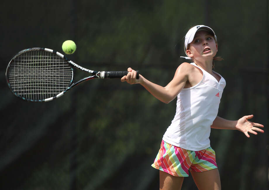 "Fiona Crawley grimaces as she hits the ball during a drill called ""torture"" while practicing at  Clarence Mabry Tennis Center at the University of Incarnate Word. Fionia is ranked No. 1 in Texas among rising fifth-graders. Photo: Julysa Sosa, San Antonio Express-News / SAN ANTONIO EXPRESS-NEWS"