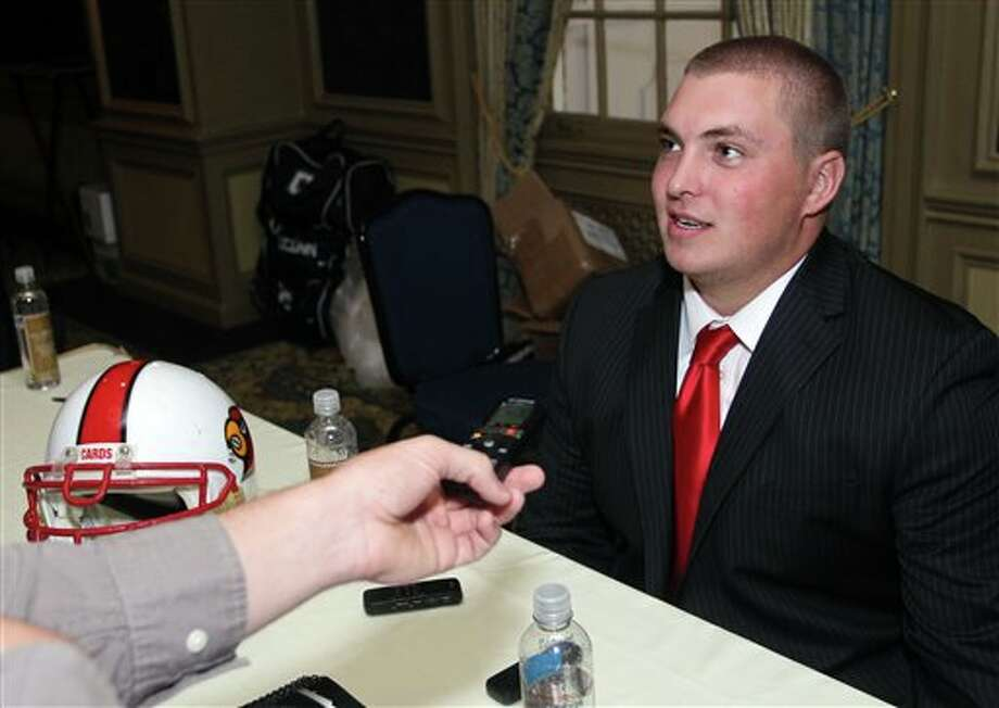 Louisville offensive tackle Alex Kupper answers questions from the media during the Big East Conference NCAA college football media day, Tuesday, July 31, 2012, Newport, R.I. (AP Photo/Stew Milne)