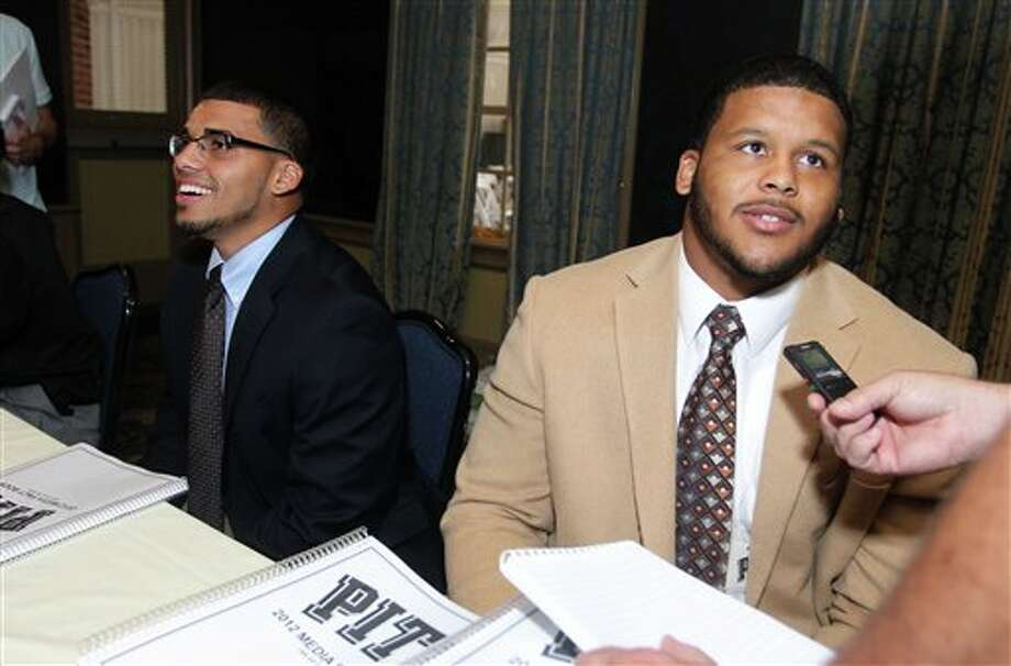 Pittsburgh defensive lineman Aaron Donald, right, and safety Jarred Holley, left, answer questions from the media during the Big East Conference NCAA college football media day, Tuesday, July 31, 2012, Newport, R.I. (AP Photo/Stew Milne)