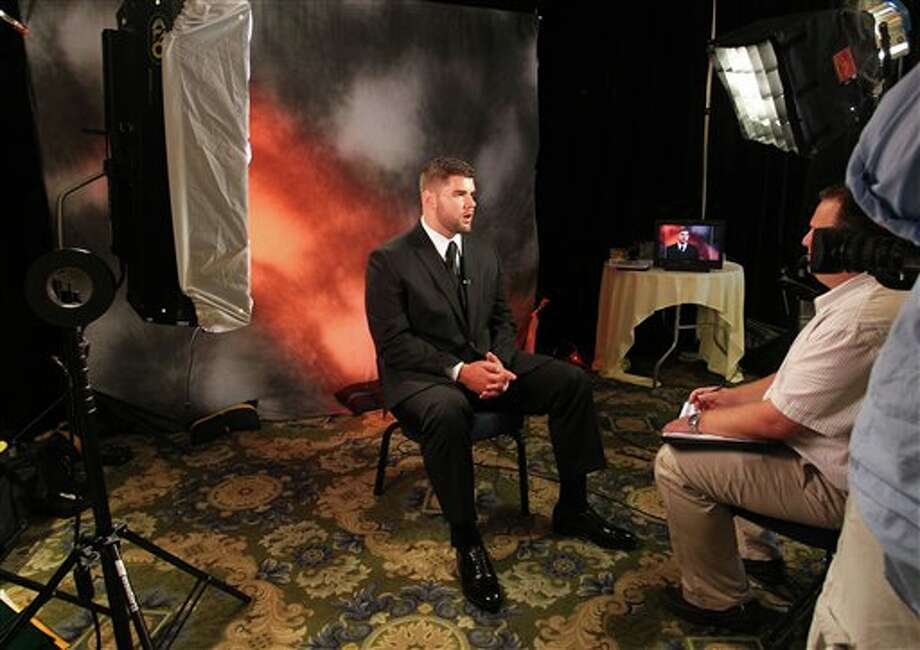 Syracuse offensive tackle Justin Pugh answers questions during an interview at the Big East Conference NCAA college football media day, Tuesday, July 31, 2012, Newport, R.I. (AP Photo/Stew Milne)