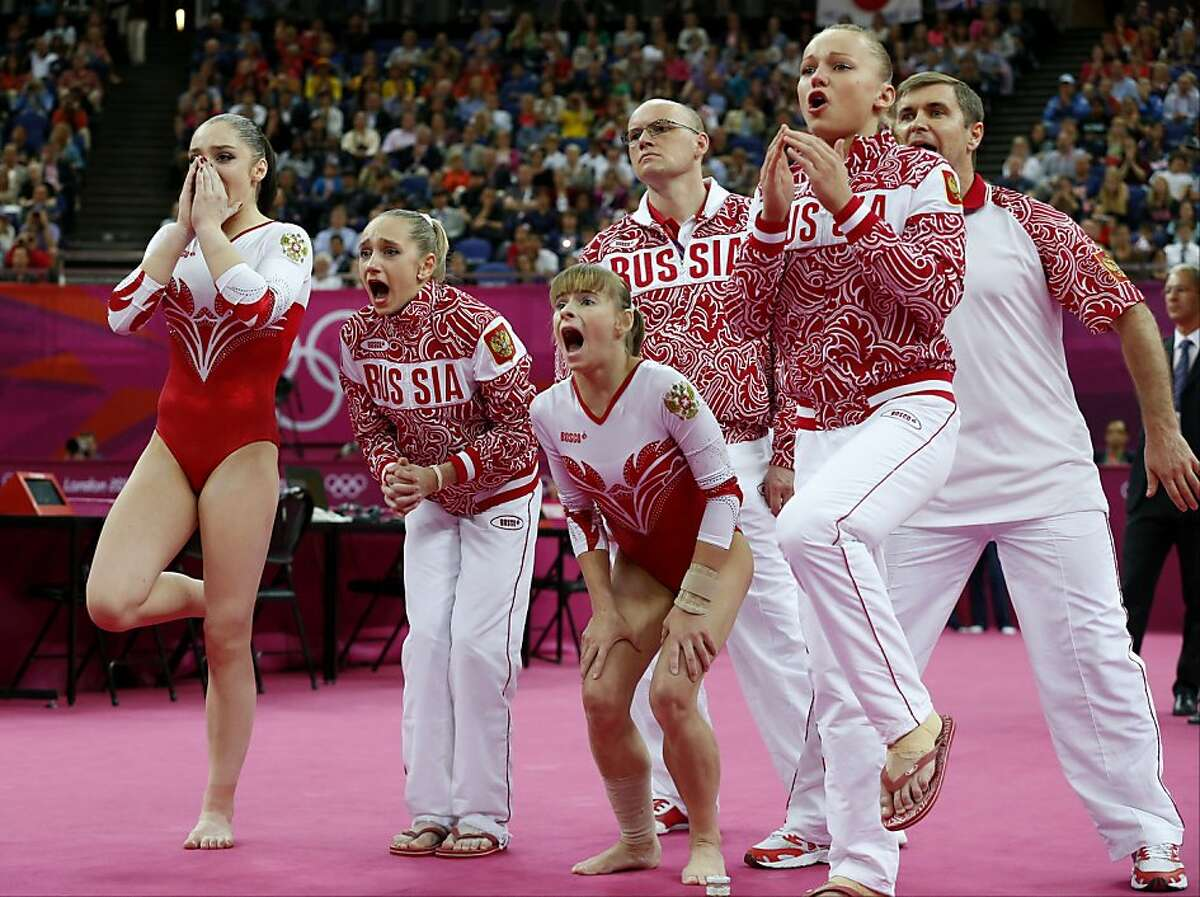 Russian gymnasts and team officials react as teammate Kseniia Afanaseva falls while performing on the floor during the Artistic Gymnastics women's team final at the 2012 Summer Olympics, Tuesday, July 31, 2012, in London. (AP Photo/Matt Dunham)