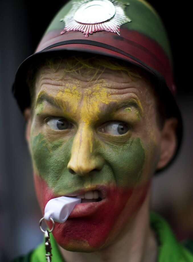 A supporter of Lithuania reacts during the team's basketball game against Nigeria at the 2012 Summer Olympics on Tuesday, July 31, 2012, in London. (AP Photo/Emilio Morenatti) Photo: Emilio Morenatti, Associated Press