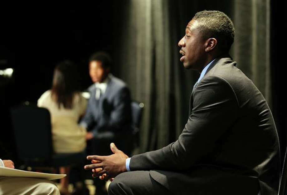 Rutgers wide receiver and Bunnell High School grad Mark Harrison answers questions during a television interview at the Big East Conference NCAA college football media day, Tuesday, July 31, 2012, Newport, R.I. (AP Photo/Stew Milne)