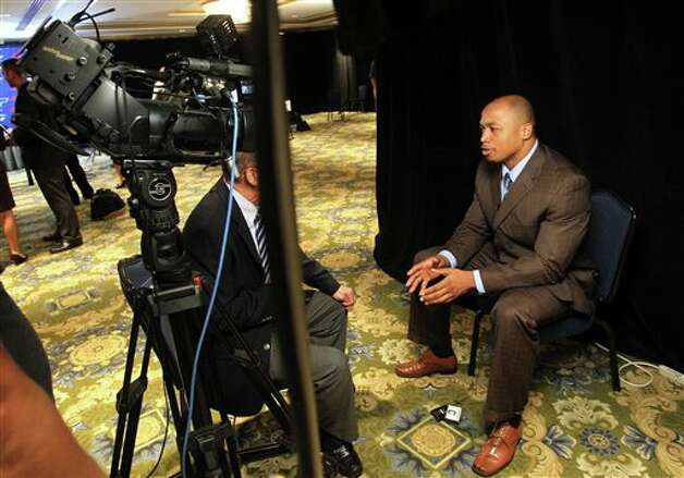 Connecticut defensive end Trevardo Williams speaks with a television crew during the Big East Conference NCAA college football media day, Tuesday, July 31, 2012, Newport, R.I. (AP Photo/Stew Milne)