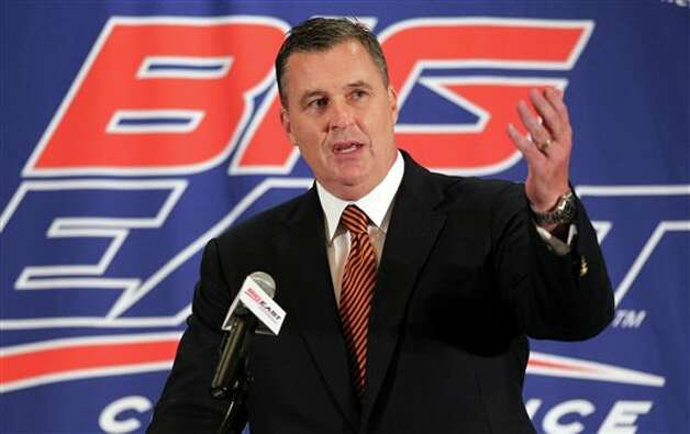 Syracuse head football coach Doug Marrone speaks with the media during the Big East Conference NCAA college football media day, Tuesday, July 31, 2012, Newport, R.I. (AP Photo/Stew Milne)