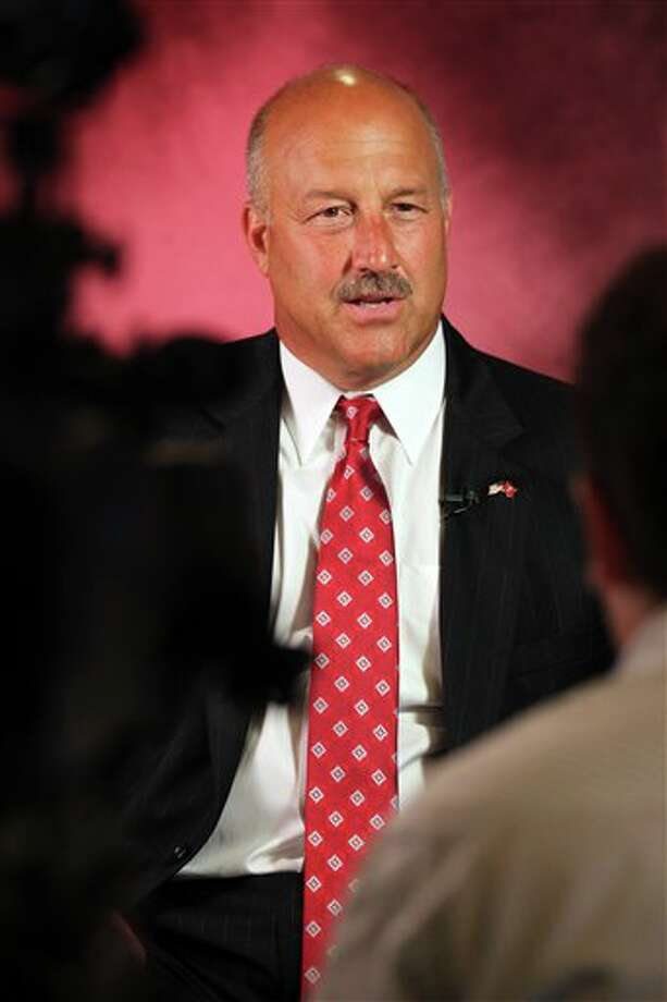 Temple head football coach Steve Addazio answers questions during a television interview during the Big East Conference NCAA college football media day, Tuesday, July 31, 2012, Newport, R.I. (AP Photo/Stew Milne)