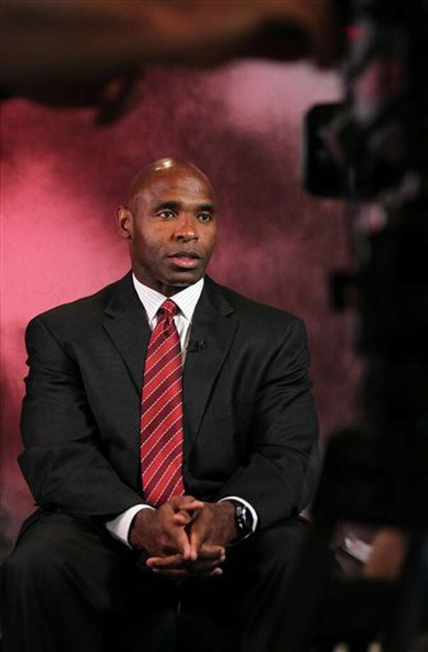 Louisville head football coach Charlie Strong sits down for a television interview during the Big East Conference NCAA college football media day Tuesday, July 31, 2012, Newport, R.I. (AP Photo/Stew Milne)