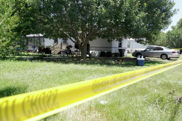 The scene of a fatal fire on Los Nietos Lane is seen Tuesday July 31, 2012 in Guadalupe County near Seguin. Two children -- age 5 and 15 -- and their mother died in the fire. A fourth person survived. Photo: William Luther, San Antonio Express-News / © 2012 San Antonio Express-News