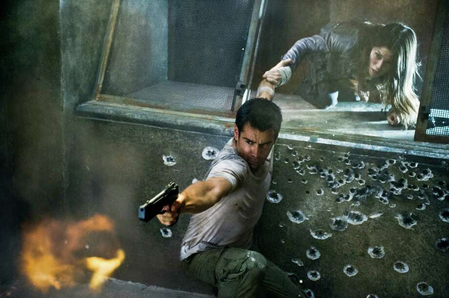 "This film image released by Columbia Pictures shows Jessica Biel, right, and Colin Farrell in a scene from the action thriller ""Total Recall."" Photo: AP"