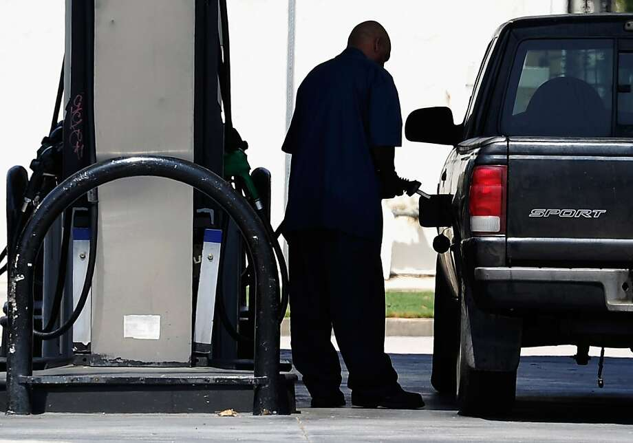 LOS ANGELES, CA - JULY 02:  Customers pump gas at an Arco station on July 2, 2012 in Los Angeles, California. According to a gasoline industry tracker, recent dropping gas prices will help encourage holiday travelers in Southern California. The Automobile Club of Southern California reports that gas prices in Southern Califiornia peaked at $4.41 a gallon during the surge and now are 66 cents lower.  (Photo by Kevork Djansezian/Getty Images) Photo: Kevork Djansezian, Getty Images