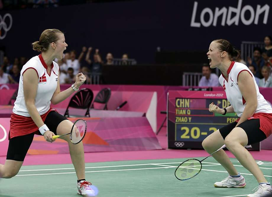 Denmark's Christinna Pedersen, left, and Kamilla Rytter Juhl celebrate after winning the first game of the women's doubles badminton match against Tian Qing and Zhao Yunlei of China, at the 2012 Summer Olympics, Tuesday, July 31, 2012, in London. (AP Photo/Andres Leighton) Photo: Andres Leighton, Associated Press
