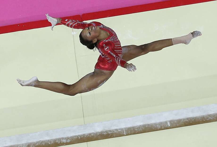 U.S. gymnast Gabrielle Douglas performs on the balance beam during the Artistic Gymnastic women's team final at the 2012 Summer Olympics, Tuesday, July 31, 2012, in London. (AP Photo/Julie Jacobson) Photo: Julie Jacobson, Associated Press