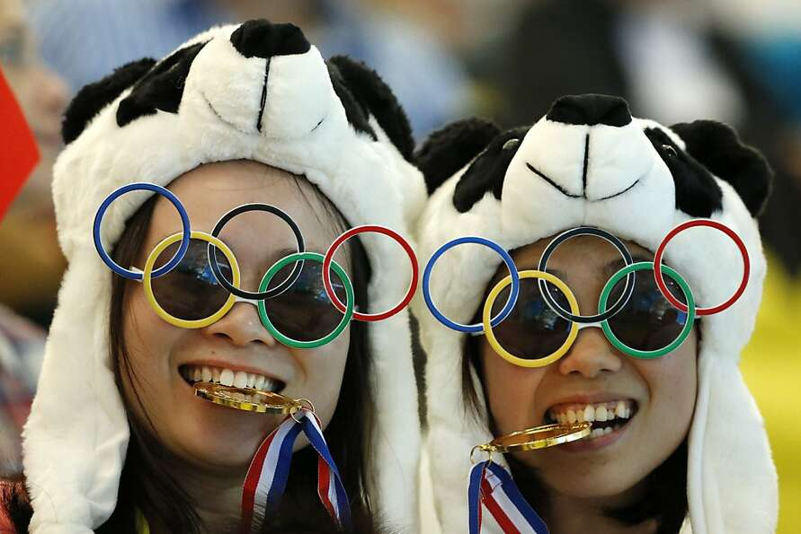 Two Chinese fans pause for photos prior to the Women's Synchronized 10 Meter Platform Diving final a