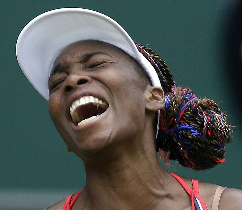Venus Williams of the United States screams during her match against Aleksandra Wozniak of Canada at the All England Lawn Tennis Club in Wimbledon, London at the 2012 Summer Olympics, Tuesday, July 31, 2012. (AP Photo/Elise Amendola) Photo: Elise Amendola, Associated Press