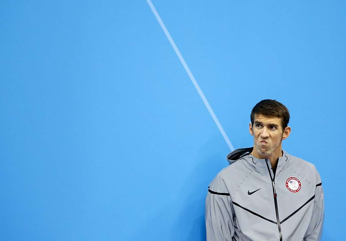 United States' Michael Phelps waits to receive his silver medal for the men's 200-meter butterfly swimming final at the Aquatics Centre in the Olympic Park during the 2012 Summer Olympics in London, Tuesday, July 31, 2012. (AP Photo/Daniel Ochoa De Olza)