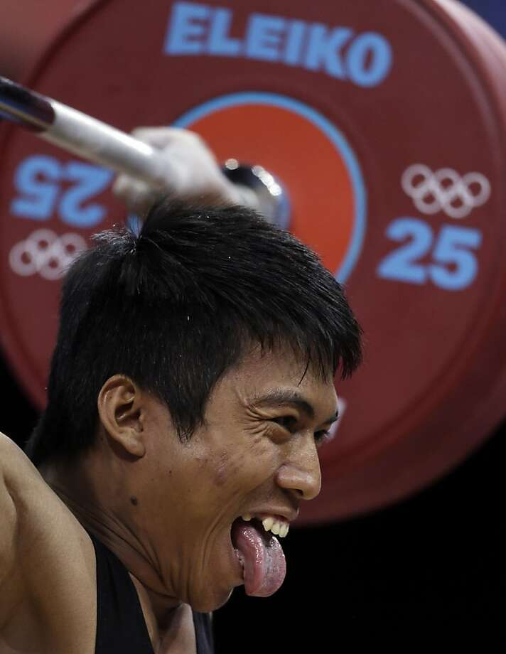 Deni Deni of Indonesia competes during the men's 69-kg weightlifting competition at the 2012 Summer Olympics, Tuesday, July 31, 2012, in London. (AP Photo/Mike Groll) Photo: Mike Groll, Associated Press