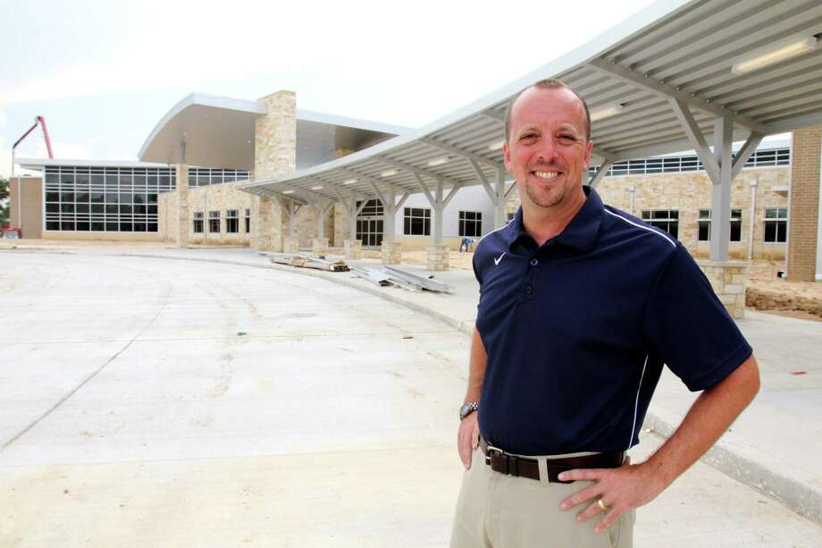 Scott Wagoner, principal of Wolfe Elementary, stand near the school's front entrance. Photo: Suzanne Rehak